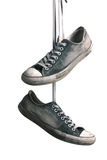 Hanged sneakers Royalty Free Stock Photo