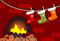 Hanged stockings on a fireplace. A fireplace with three stockings hanged by children at Epiphany ready to be filled Stock Image