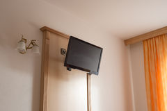 Hanged TV panel. Light room interior with TV panel hanged on the wall Royalty Free Stock Photos