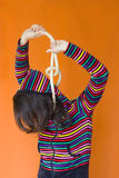 Hanged woman. A frustrated woman trying to hang her self Stock Photo