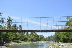 Hangende die brug in barangay Ruparan, Digos-Stad, Davao del Sur, Filippijnen wordt gevestigd stock afbeeldingen
