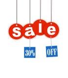 Hangende verkoopbrief en kortingsmarkering met het knippen Stock Foto