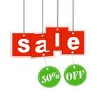 Hangende verkoopbrief en kortingsmarkering met het knippen Stock Foto's