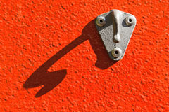 Hanger. On red textured wall Stock Photos