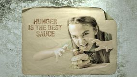 Hanger is the best sauce. Old paper ad on a cement wall with a portrait of a girl with hamburger and inscription hanger is the best sauce. imitation of camera stock video footage