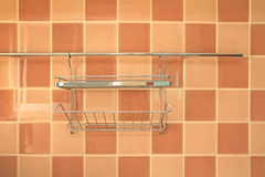 Hanger on brown square tiles pattern Royalty Free Stock Photography