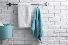 Hanger with clean towels. On brick wall Stock Photos