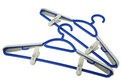 Hanger for clothes. Of dark blue colour on a white background Stock Photos