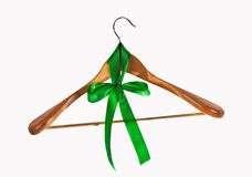 Hanger for clothes and a green tape, a bow Royalty Free Stock Photos