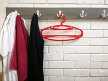 Hanger, clothes and red towel. In dressing room in gym Stock Photo