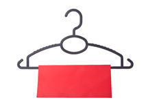 Hanger. coat hanger with tag on background Royalty Free Stock Photo