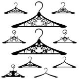 Hanger design. Luxurious hanger design set - black and white vector outlines and silhouette collection Royalty Free Stock Photography