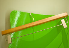 Hanger on green stool Royalty Free Stock Photos