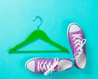 Hanger and gumshoes. On blue background Stock Image