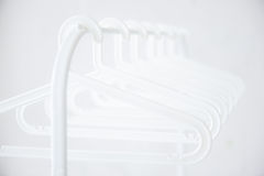 Hanger3. Hangers in the row on the rail Royalty Free Stock Image