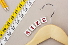 Hanger and Measuring Tape Royalty Free Stock Image