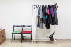 Hanger with outerwear in interior hallway room Stock Image