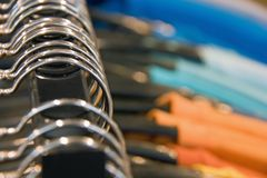 Hanger in a shop with colorful clothes. Black friday concept. Front view Stock Image