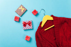 Hanger with sweater and gift boxes Royalty Free Stock Photo