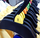 Hanger various sizes hanging in a department store Stock Photography