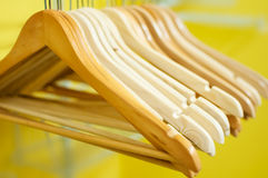 Hangers. A bunch of wooden empty hanging hangers Royalty Free Stock Image