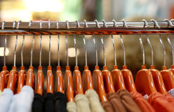 Hangers. Brown clothes hangers arranged in a row in a shop Royalty Free Stock Photo