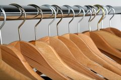 Hangers. Coat hangers on gray Stock Photos