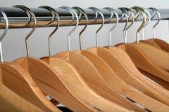 Hangers. Coat hangers on gray stock photos