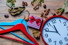 Hangers, clock, gift and fallen leaves Royalty Free Stock Photo