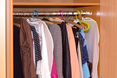 Hangers with clothes. Inside wardrobe Royalty Free Stock Image