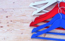 Hangers for clothes lie on the shelf Royalty Free Stock Image