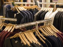 Hangers with different clothes in wardrobe closet.  royalty free stock photo