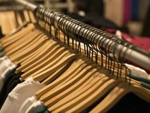Hangers with different clothes in wardrobe closet.  stock images