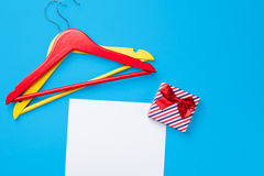 Hangers and gift near paper Royalty Free Stock Photo