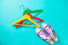 Hangers and gumshoes. Colorful Hangers and gumshoes on blue background Stock Photography