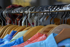 Hangers on pole for hanging clothing in closet storage Stock Photo