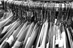 Hangers on pole for hanging clothing in closet storage Royalty Free Stock Photography