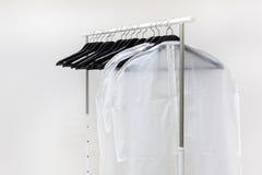 Hangers on rack Stock Photos