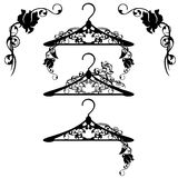 Hangers among rose flowers Stock Image