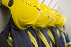 HangFirefighter's coats and helmets Stock Photos