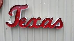 Hangin de signe du Texas en métal sur le mur Images libres de droits