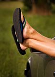 Hangin' Out. Guy's feet hanging out of a car window Royalty Free Stock Images