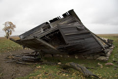 Hanging On. This house has been collapsing slowly for the last five years Stock Image