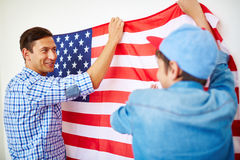 Hanging American flag on wall Stock Photo