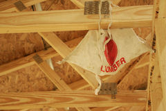 Hanging Apron. Construction Worker's apron hanging from rafters Royalty Free Stock Photos
