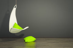 Hanging armchair with green pillows. 3d rendering of a hanging armchair with green pillows and space for your content Royalty Free Stock Images