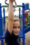 Hanging around. Young girl plays on school playground during recess Stock Photo