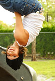 Hanging Around. Young kid hanging on a playground Stock Photo