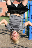 Hanging Around. Young boy playing and hanging upside down Stock Photos