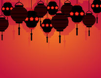 Hanging Asian lanterns. Colorful red background with hanging Chinese lanterns and space for text Royalty Free Stock Photos